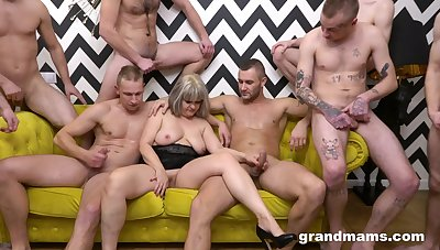 Naked mature is in the thick of younger lads waiting to mad about her hard
