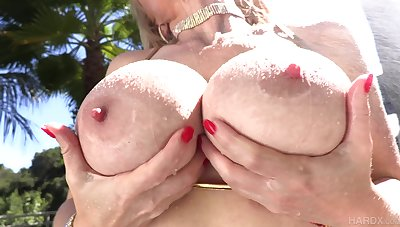 Older blonde Casca Akashova has a horniness as big as her tits