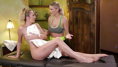 Two busty blondes are jilling each others pussies unaffected by chum around with annoy palpate gaming-table