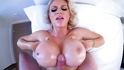 Blonde Russian MILF uses huge tits and mouth to accept the blame for boner