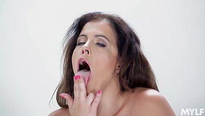 mature Montse Swinger masturbates on the bed using blue dildo