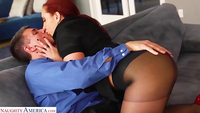 Bright red haired wholesale Kelly Divine gets her pussy fucked in ripped pantyhose