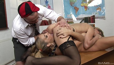 Bitches share dick in the lecture-hall for a complete fetish play