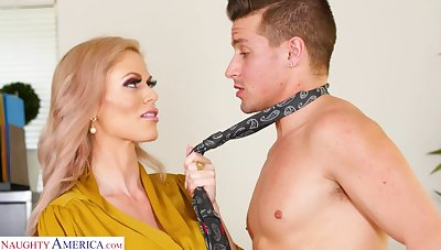 Big titted MILF boss turns a young man into her boy plaything