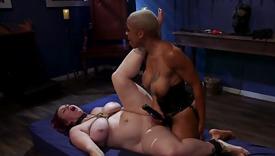 Black mistress is strap-on bonking her constrained up slavegirl
